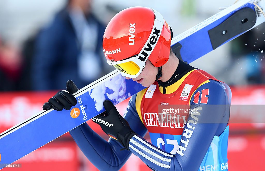 Andreas Wellinger of Austria reacts during the qualification round for the FIS Ski Jumping World Cup event of the 61st Four Hills ski jumping tournament at Olympiaschanze on December 31, 2012 in Garmisch-Partenkirchen, Germany.