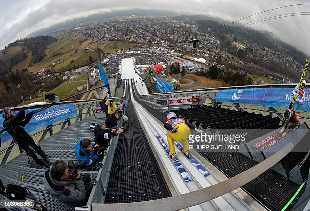 Andreas Wellinger of Germany begins his jump of the FourHills Ski Jumping tournament in GarmischPartenkirchen southern Germany on January 01 2016 The...