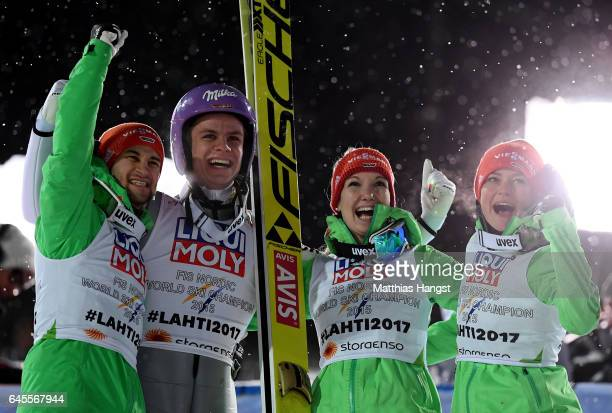 Andreas Wellinger of Germany celebrate with his team mates after landing his second jump in the Mixed Team HS100 Normal Hill Ski Jumping during the...
