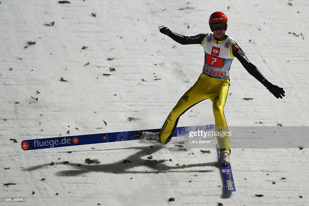 Andreas Wellinger of Germany celebrates and falls down during the first round for the FIS Ski Jumping World Cup event of the 61st Four Hills ski jumping tournament at Paul-Ausserleitner-Schanze on January 6, 2013 in Bischofshofen, Austria.