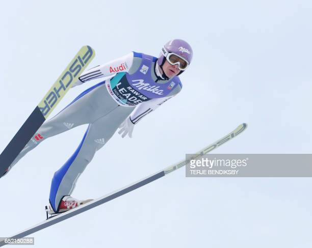 Andreas Wellinger of Germany competes during the Men Large Hill team competition of the ski jumping world cup in Oslo on March 11 2017 / AFP PHOTO /...