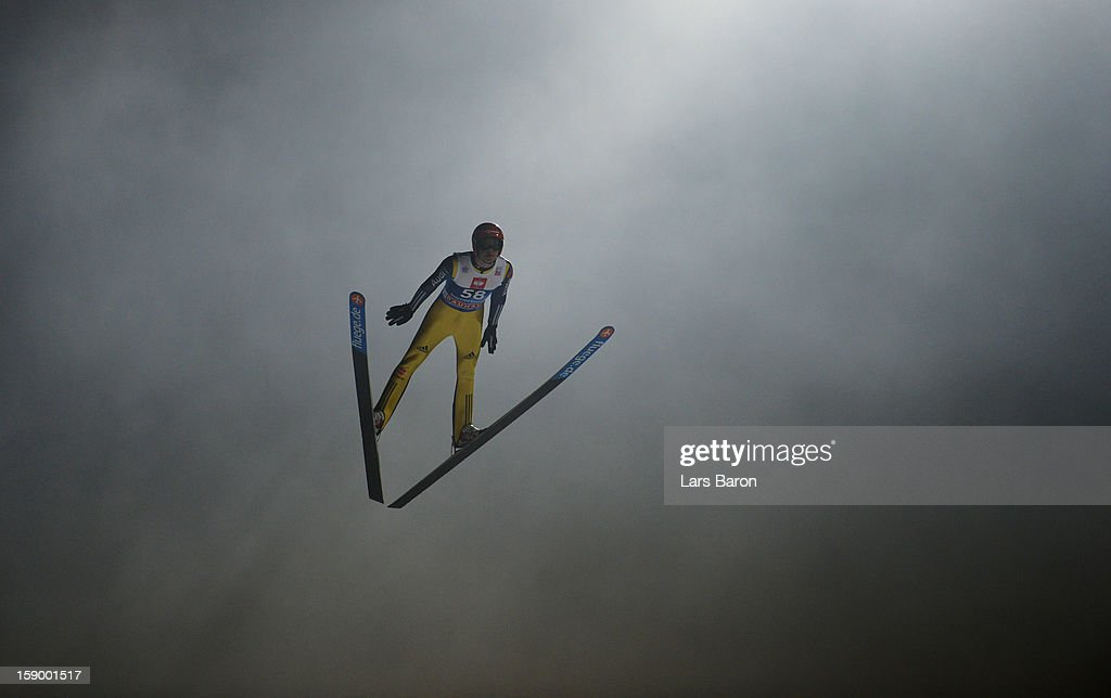 Andreas Wellinger of Germany competes during the qualification round for the FIS Ski Jumping World Cup event of the 61st Four Hills ski jumping...