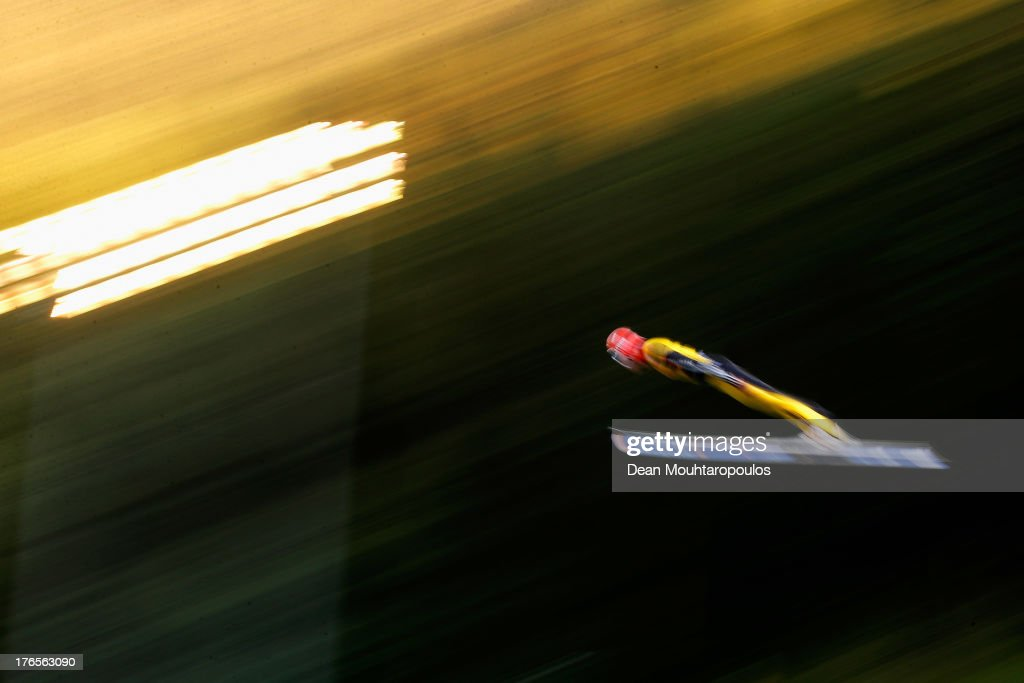 Andreas Wellinger of Germany competes in the 1st round in the FIS Ski Jumping Grand Prix Mens Large Hill Individual Final on August 15, 2013 in Courchevel, France.