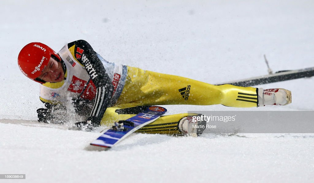 Andreas Wellinger of Germany falls down during the final round of the FIS Ski Jumping World Cup event at the 61st Four Hills ski jumping tournament...