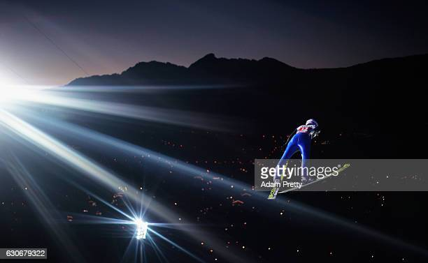 Andreas Wellinger of Germany soars through the air during his first competition jump on Day 2 of the 65th Four Hills Tournament ski jumping event on...