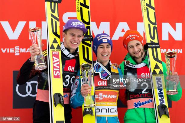 Andreas Wellinger of Germany Stefan Craft of Austria and Markus Eisenbichler of Germany pose for a picture during the victory ceremony Planica FIS...