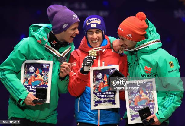Andreas Wellinger of Germany Stefan Kraft of Austria and Markus Eisenbichler of Germany celebrate with their medals after the Men's Ski Jumping HS100...