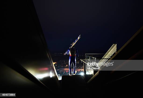 Andreas Wellinger of Germany walks out for the Men's Large Hill Team Ski Jumping training during the FIS Nordic World Ski Championships at the Lugnet...