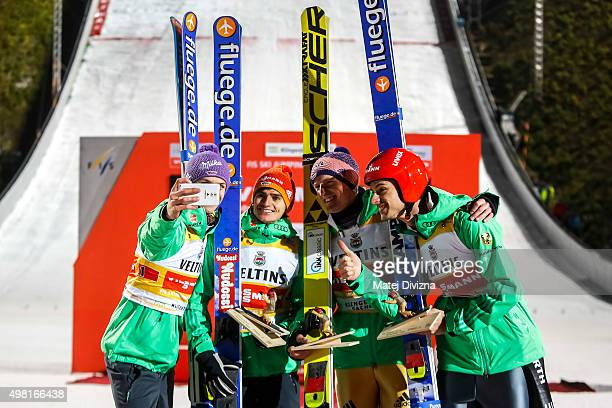 Andreas Wellinger Richard Freitag Severin Freund and Andreas Wank from Germany make 'selfie' in front of photographers as they won the team...