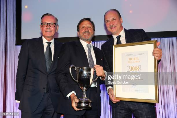 Andreas Wilkes Sir Rocco Forte and Frank Heller Managing Director Hotel 'The Charles' with award during the 2oth 'Busche Gala' at The Charles Hotel...