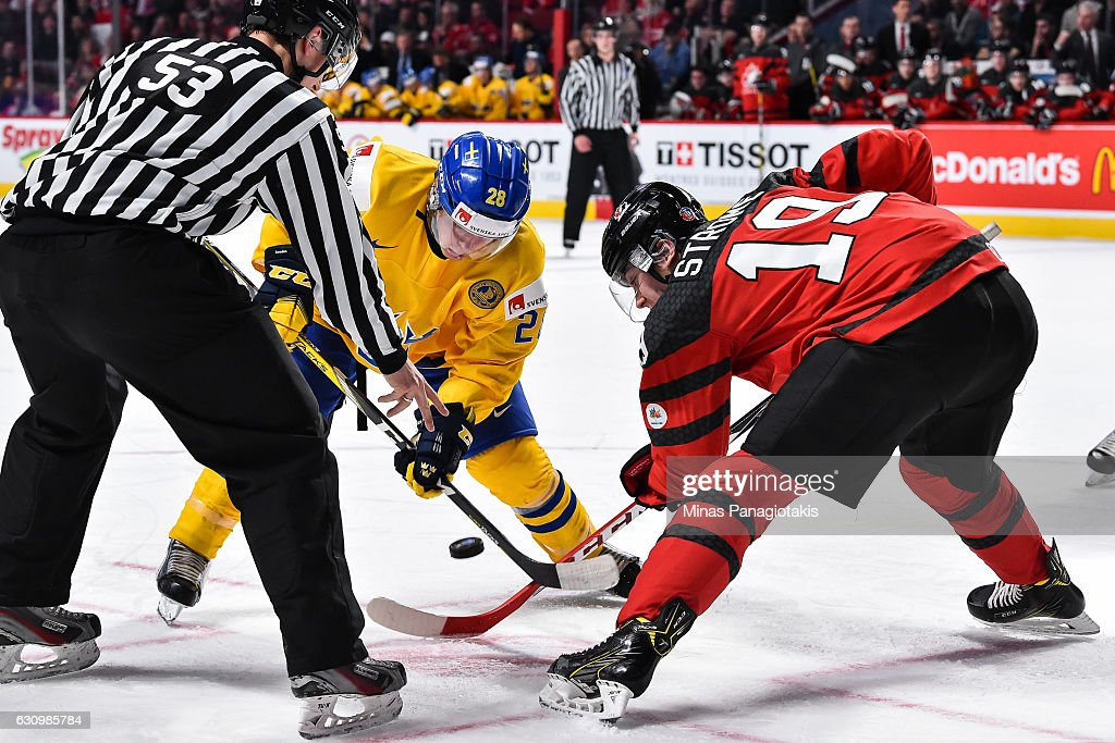 Andreas Wingerli #28 of Team Sweden and Dylan Strome #19 of Team Canada face-off during the 2017 IIHF World Junior Championship semifinal game at the Bell Centre on January 4, 2017 in Montreal, Quebec, Canada.