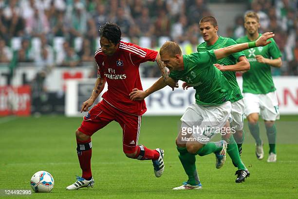 Andreas Wolf of Bremen and Paolo Guerrero of Hamburg battle for the ball during the Bundesliga match between Werder Bremen and Hamburger SV at Weser...