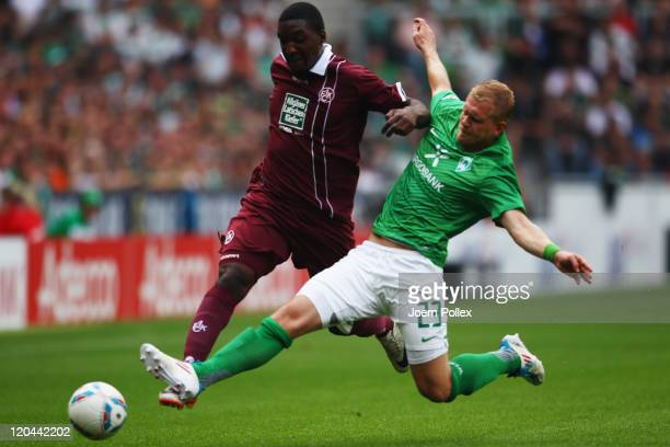 Andreas Wolf of Bremen and Richard SukutaPasu of Kaiserslautern battle for the ball during the Bundesliga match between SV Werder Bremen and 1 FC...