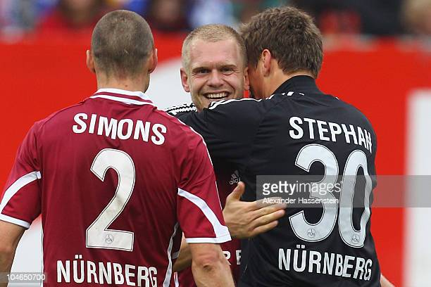 Andreas Wolf of Nuernberg celebrates victory with his team mates Alexander Stephan and Timmy Simons after the Bundesliga match between 1 FC Nuernberg...