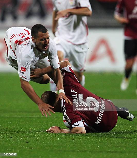 Andreas Wolf of Nuernberg fights for the ball with Timo Gebhart of Stuttgart during the Bundesliga first league match between 1 FC Nuernberg and VfB...
