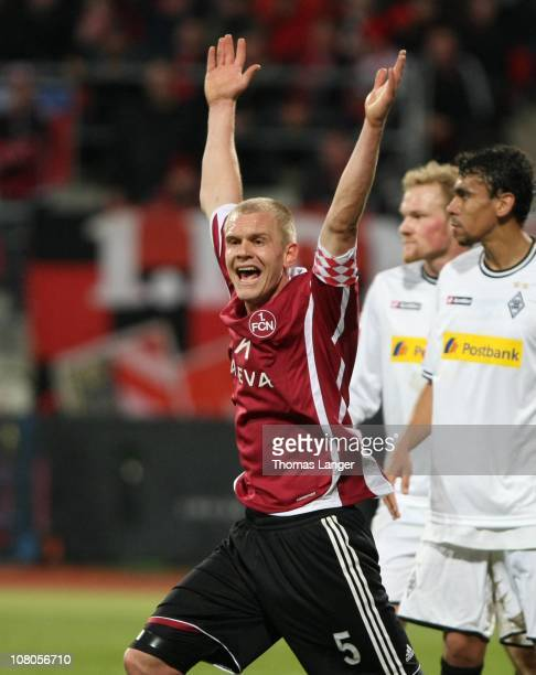 Andreas Wolf of Nuernberg reacts during the Bundesliga match between 1 FC Nuernberg and Borussia Moenchengladbach at the Easy Credit Stadium on...