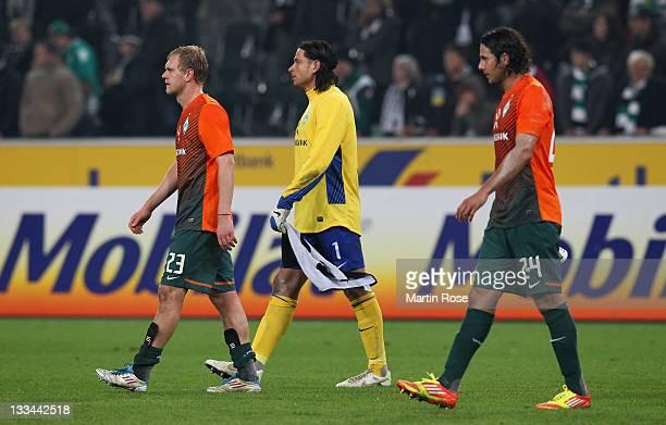 Andreas Wolf Tim Wiese and Claudio Pizarro of Bremen look dejected after the Bundesliga match between Borussia Moenchengladbach and SV Werder Bremen...