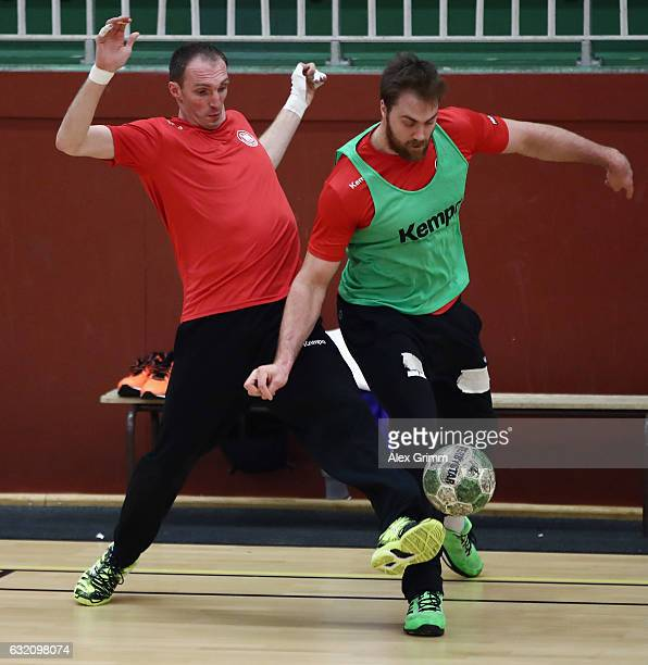 Andreas Wolff is challenged by Holger Glandorf during a Germany training session at Germinal during the 25th IHF Men's World Championship 2017 on...