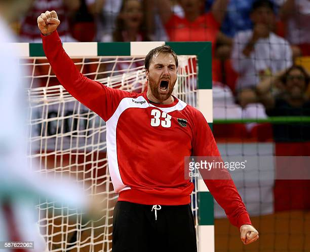 Andreas Wolff of Germany celebrates after he stopped a shot in the secondl half against Poland on Day 4 of the Rio 2016 Olympic Games at the Future...