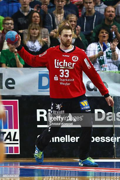 Andreas Wolff of Wetzlar passes the ball during the DKB Handball Bundesliga match between HSG Wetzlar and SG Flensburg at Rittal Arena on December 14...