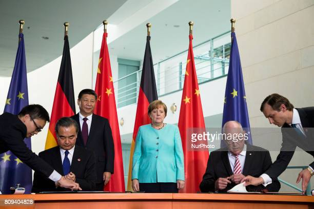 Andreas Wolke of the DLR and a member of Chinese Environment Agency sign a cooperation agreement durign a signing ceremony at the presence of German...