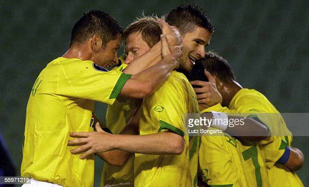 Andreas Zecke Neuendorf of Berlin celebrates with Pal Dardai and other team mates after scoring the 1st goal during the UEFA Cup Group C match...