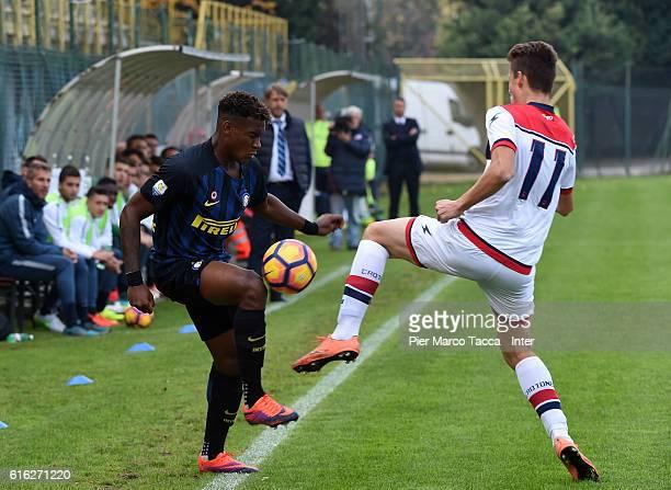 Andreaw Gravillon of FC Internazionale Primavera competes for the ball with Edgaras Dubickas of FC Crotone during the Primavera Tim juvenile match...