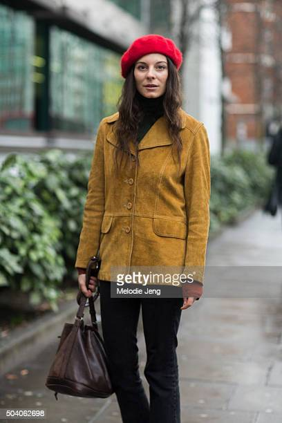 Andreea Bogdan wears a vintage outfit with a suede buttonup jacket and red beret during The London Collections Men AW16 on January 8 2016 in London...