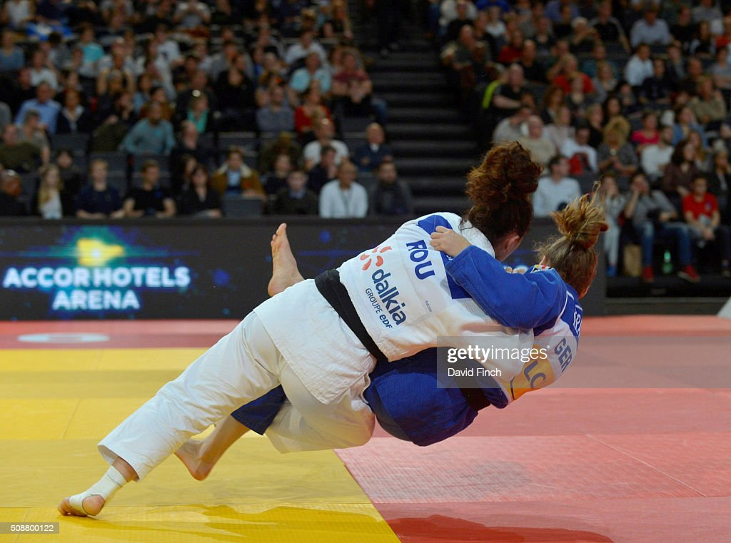 Andreea Chitu of Romania throws Mareen Kraeh of Germany for an ippon to reach the u52kg final and the silver medal during the 2016 Paris Judo Grand...