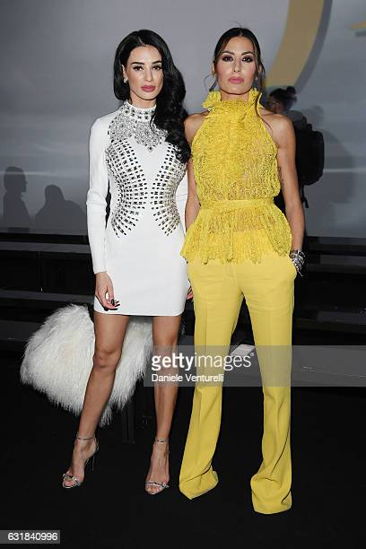 Andreea Sasu and Elisabetta Gregoraci attend the Billionaire show during Milan Men's Fashion Week Fall/Winter 2017/18 on January 16 2017 in Milan...