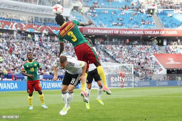 AndreFrank Zambo Anguissa of Cameroon outjumps Joshua Kimmich of Germany during the FIFA Confederations Cup Russia 2017 Group B match between Germany...