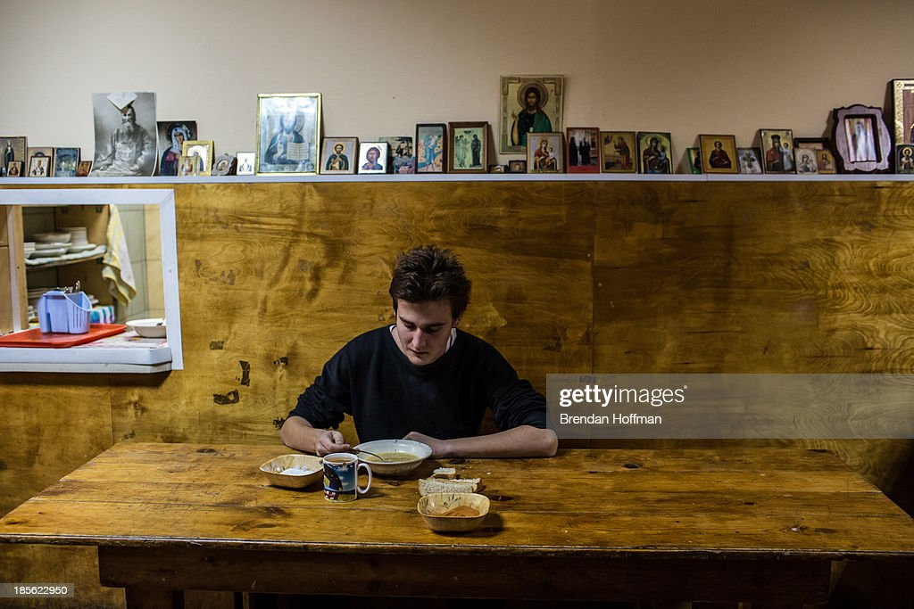 Andrei, a 23-year-old chemistry student from the Moscow region who was addicted to a synthetic form of marijuana, eats lunch at City Without Drugs on October 16, 2013 in Yekaterinburg, Russia. City Without Drugs is a well-known narcotics treatment program in Russia founded by Yevgeny Roizman, who was elected mayor of Yekaterinburg in September 2013.