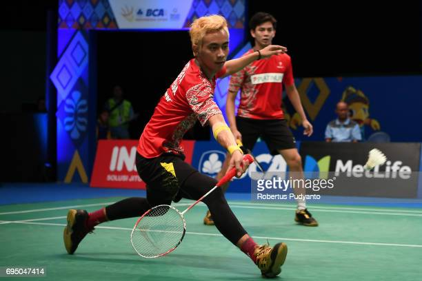 Andrei Adistia and Agripinna Prima Rahmanto Putra of Indonesia compete against Jian Yi Lee and Zhen Ting Lim of Malaysia during their qualification...