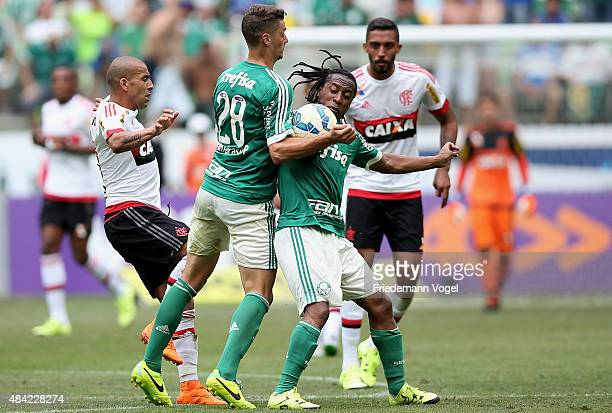 Andrei and Arouca of Palmeiras fights for the ball with Emerson of Flamengo during the match between Palmeiras and Flamengo for the Brazilian Series...