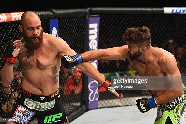 Andrei Arlovski punches Travis Browne in their heavyweight bout during the UFC 187 event at the MGM Grand Garden Arena on May 23 2015 in Las Vegas...