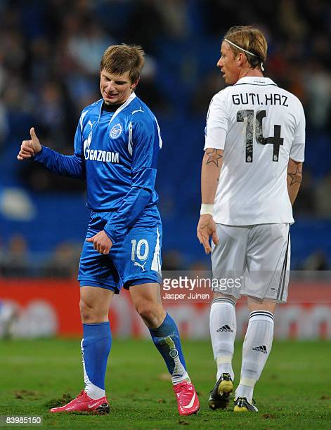 Andrei Arshavin of Zenit St Petersburg gestures to a teammate while flanked by Jose Maria Gutierrez of Real Madrid during the UEFA Champions League...
