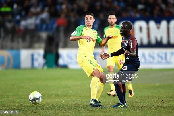 Andrei Girotto of Nantes and Jonathan Ikone of Montpellier during the Ligue 1 match between Montpellier Herault SC and Nantes at Stade de la Mosson...