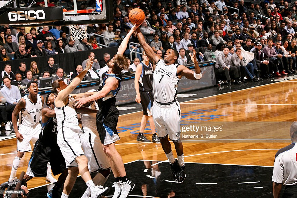 Andrei Kirilenkio #47 of the Minnesota Timberwolves goes for a rebound against <a gi-track='captionPersonalityLinkClicked' href=/galleries/search?phrase=Joe+Johnson+-+Basketballspieler&family=editorial&specificpeople=201652 ng-click='$event.stopPropagation()'>Joe Johnson</a> #7 of the Brooklyn Nets on November 5, 2012 at the Barclays Center in Brooklyn, New York.