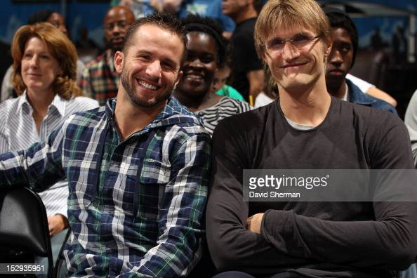 Andrei Kirilenko and Jose Barea of the Minnesota Timberwolves enjoy the game during the 2012 WNBA Western Conference Semifinals Game One between the...
