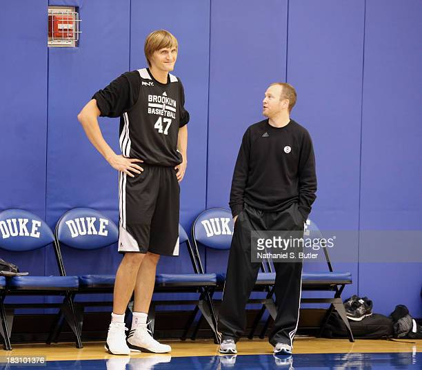 Andrei Kirilenko and Lawrence Frank of the Brooklyn Nets talk during NBATV's Real Training Camp in Durham North Carolina NOTE TO USER User expressly...