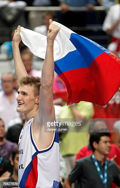 Andrei Kirilenko of Russia celebrates with a Russian flag after winning the FIBA Eurobasket 2007 final match between Spain and Russia at the Palacio...