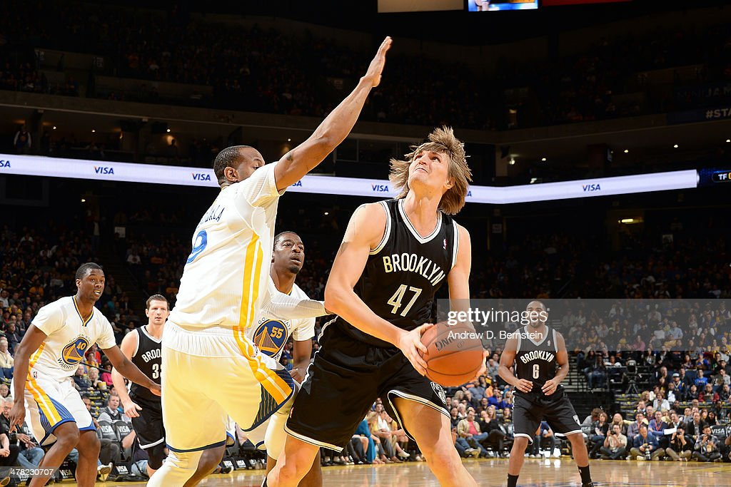 <a gi-track='captionPersonalityLinkClicked' href=/galleries/search?phrase=Andrei+Kirilenko&family=editorial&specificpeople=201909 ng-click='$event.stopPropagation()'>Andrei Kirilenko</a> #47 of the Brooklyn Nets handles the ball against the Golden State Warriors at Oracle Arena on February 22, 2014 in Oakland, California.