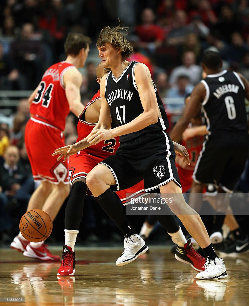 <a gi-track='captionPersonalityLinkClicked' href=/galleries/search?phrase=Andrei+Kirilenko&family=editorial&specificpeople=201909 ng-click='$event.stopPropagation()'>Andrei Kirilenko</a> #47 of the Brooklyn Nets moves against <a gi-track='captionPersonalityLinkClicked' href=/galleries/search?phrase=Taj+Gibson&family=editorial&specificpeople=4029461 ng-click='$event.stopPropagation()'>Taj Gibson</a> #22 of the Chicago Bulls at the United Center on February 13, 2014 in Chicago, Illinois. The Bulls defeated the Nets 92-76.