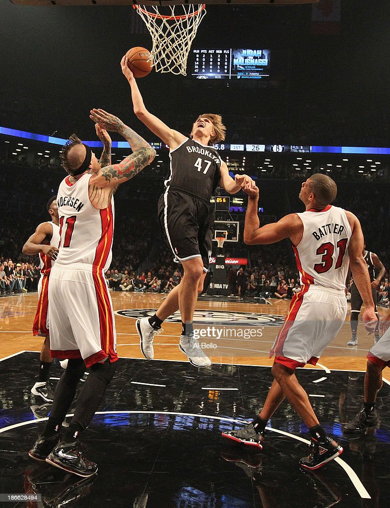 <a gi-track='captionPersonalityLinkClicked' href=/galleries/search?phrase=Andrei+Kirilenko&family=editorial&specificpeople=201909 ng-click='$event.stopPropagation()'>Andrei Kirilenko</a> #47 of the Brooklyn Nets shoots against Chris Andersen, and <a gi-track='captionPersonalityLinkClicked' href=/galleries/search?phrase=Shane+Battier&family=editorial&specificpeople=201814 ng-click='$event.stopPropagation()'>Shane Battier</a> #31 of the Miami Heat during their game at the Barclays Center on November 1, 2013 in the Brooklyn borough of New York City.