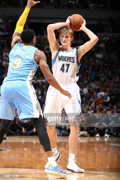 Andrei Kirilenko of the Minnesota Timberwolves aims for a pass against Andre Iguodala of the Denver Nuggets during the game between the Minnesota...