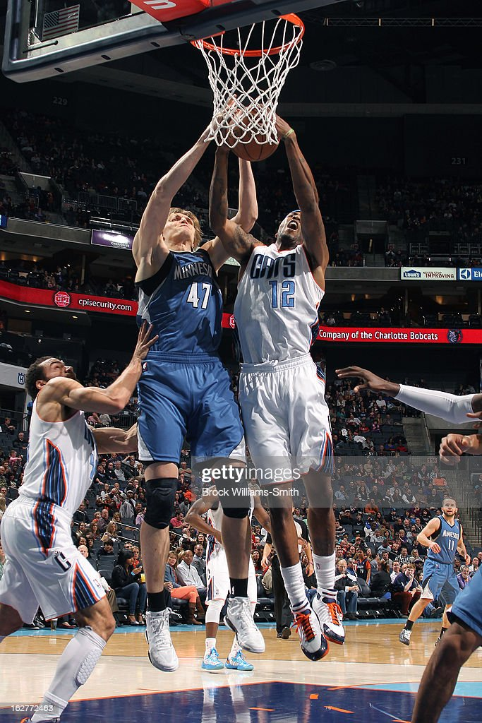 <a gi-track='captionPersonalityLinkClicked' href=/galleries/search?phrase=Andrei+Kirilenko&family=editorial&specificpeople=201909 ng-click='$event.stopPropagation()'>Andrei Kirilenko</a> #47 of the Minnesota Timberwolves and <a gi-track='captionPersonalityLinkClicked' href=/galleries/search?phrase=Tyrus+Thomas&family=editorial&specificpeople=453285 ng-click='$event.stopPropagation()'>Tyrus Thomas</a> #12 of the Charlotte Bobcats both go up for a rebound at the Time Warner Cable Arena on January 26, 2013 in Charlotte, North Carolina.