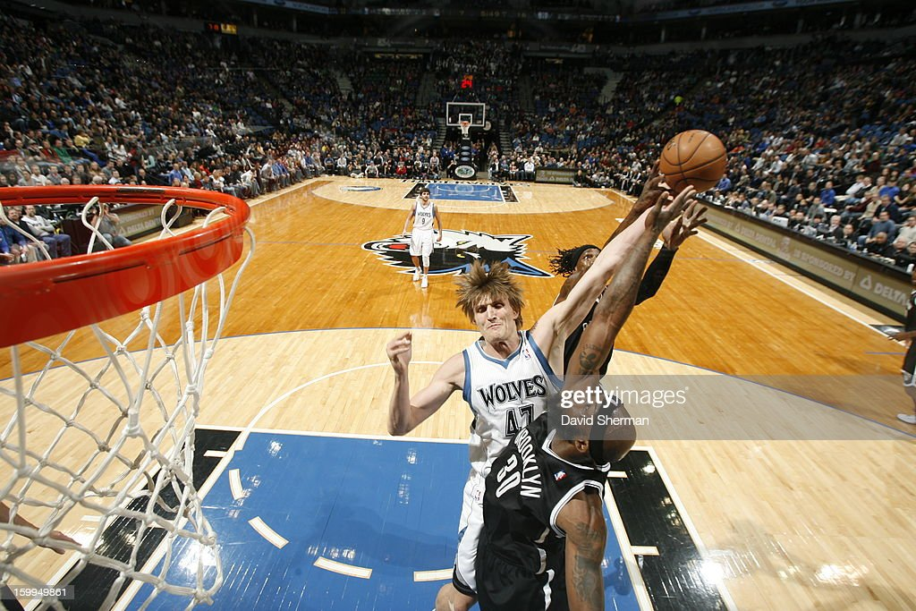 Andrei Kirilenko #47 of the Minnesota Timberwolves battles for the ball control with Reggie Evans #30 of the Brooklyn Nets and Gerald Wallace #45 of the Brooklyn Nets during the game between the Minnesota Timberwolves and the Brooklyn Nets on January 23, 2013 at Target Center in Minneapolis, Minnesota.