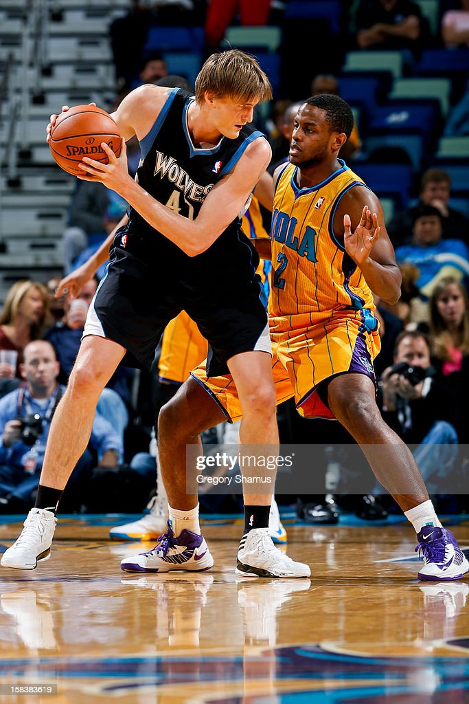 Andrei Kirilenko #47 of the Minnesota Timberwolves controls the ball against Darius Miller #2 of the New Orleans Hornets on December 14, 2012 at the New Orleans Arena in New Orleans, Louisiana.