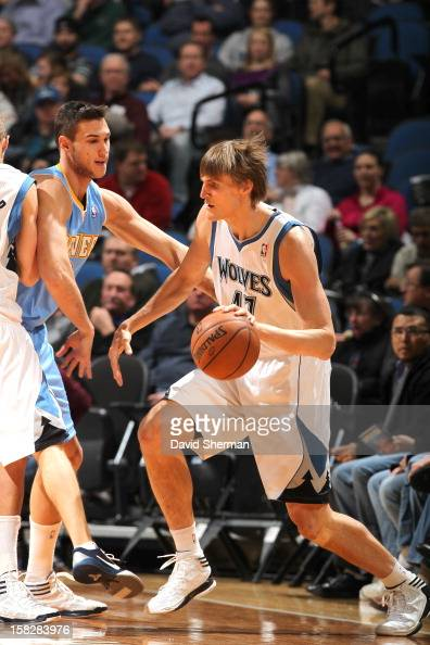 Andrei Kirilenko of the Minnesota Timberwolves drives against Danilo Gallinari of the Denver Nuggets during the game between the Minnesota...