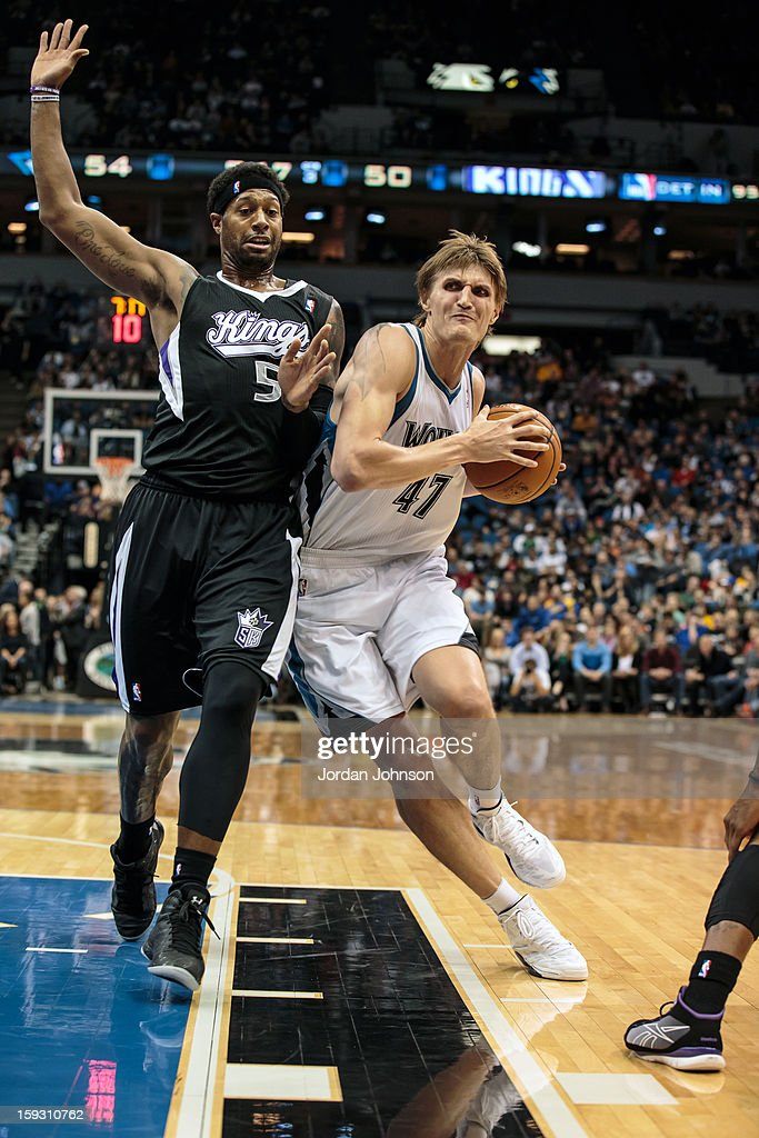 Andrei Kirilenko #47 of the Minnesota Timberwolves drives to the basket against <a gi-track='captionPersonalityLinkClicked' href=/galleries/search?phrase=John+Salmons&family=editorial&specificpeople=202524 ng-click='$event.stopPropagation()'>John Salmons</a> #5 of the Sacramento Kings during the season opening game on November 2, 2012 at Target Center in Minneapolis, Minnesota.
